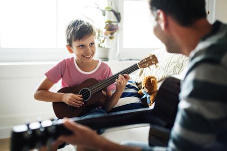 Young boy playing guitar Foto de archivo
