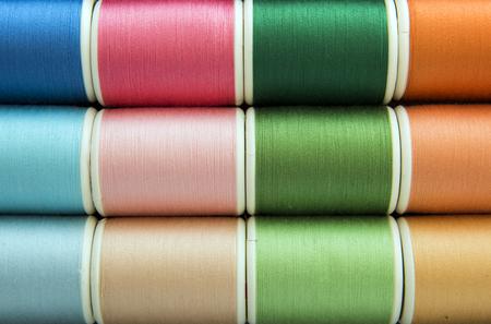 Colorful sewing threads background closeup Archivio Fotografico - 95972746