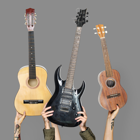 Hands holding up string instruments