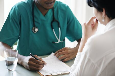 Doctor diagnose patient symptoms at the hospital Stock Photo