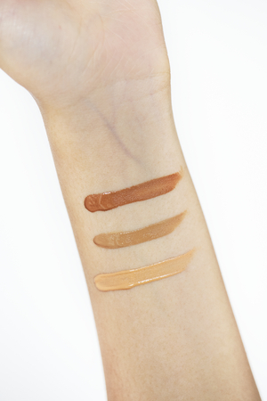 Woman testing cosmetic products