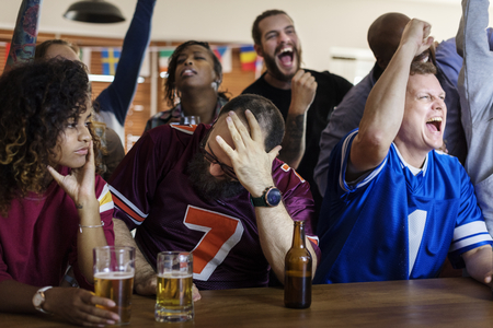 Frieds cheering sport at bar together Archivio Fotografico