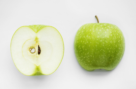 Macro shot of green apple isolated on white background 写真素材