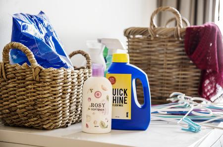 Laundry box and liquid detergents Stock Photo