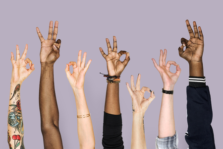 Hand holding variation of object Banco de Imagens