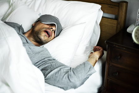 A man sleeping on a bed Stockfoto