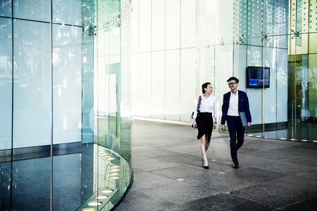 Business people discussing while walking together