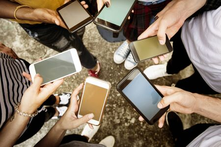 Young adults using smartphones in a circle social media and connection concept