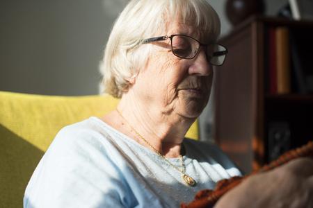 Senior woman knitting for hobby at home Standard-Bild - 96873495