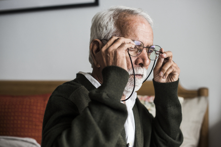 An elderly Indian man at the retirement house wearing a pair of spectacless