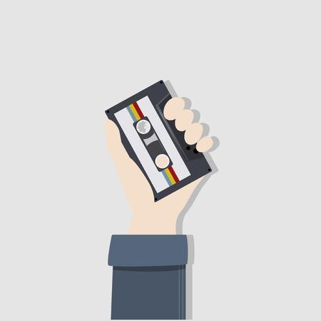 Hand holding a cassette tape concept 版權商用圖片