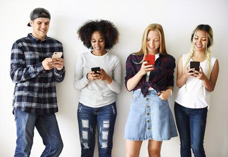 Friends using smartphones social media concept