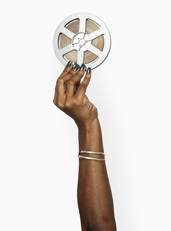 Hand holding a film reel