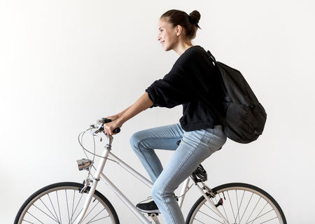 White woman riding a bike
