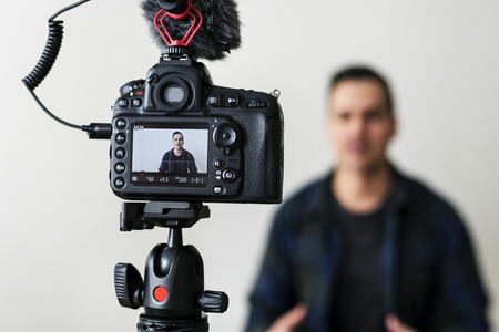 White blogger recording video Stock Photo