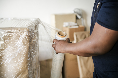 Black man moving furniture