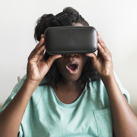 Woman amazed at a virtual reality headset Reklamní fotografie