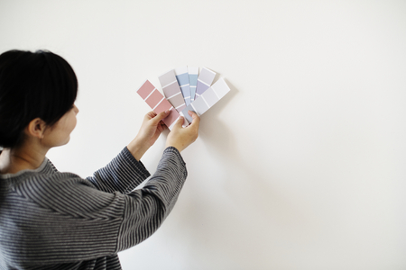 Asian woman choosing wall color