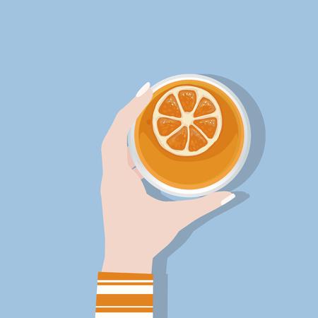 Hand holding orange juice Stock Photo