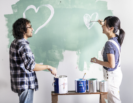 Asian couple renovating the house Stock Photo