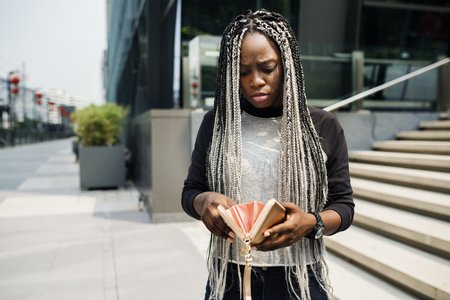 African descent checking her wallet