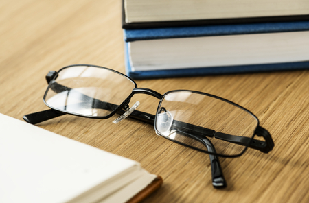 A pair of glasses and books educational, academic and literary concept Stock Photo