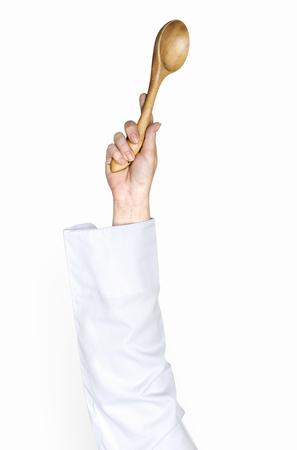 Hand holding a wooden spoon Reklamní fotografie