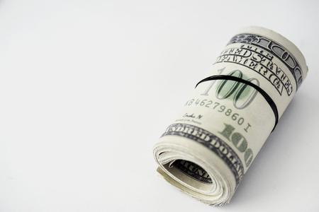 Closeup of money bundle isolated on white background