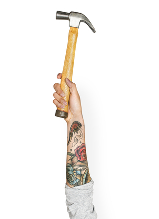 Hand holding a hammer 스톡 콘텐츠