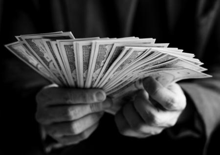 Closeup of hands holding cash Фото со стока