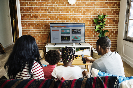 African family watching television together Banque d'images
