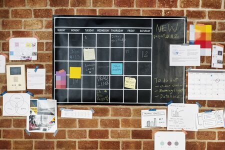 Project planner on brick wall