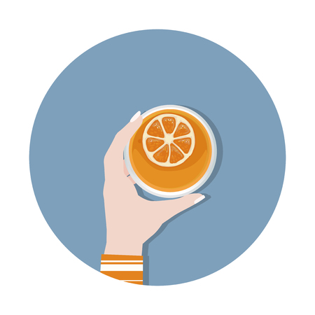 Hand holding an orange cocktail