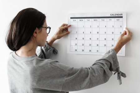 Woman checking the calendar