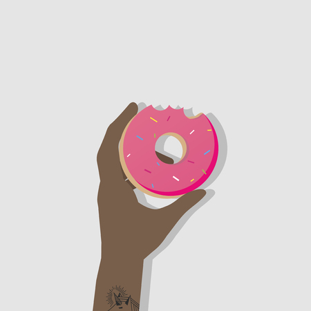 Hand holding a donut