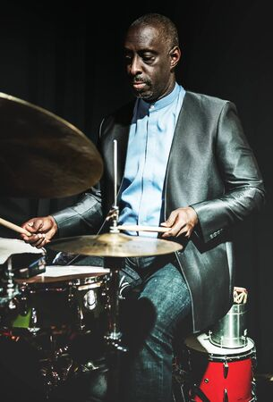 Drummer performing in an event Stock Photo