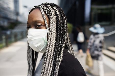 Portrait of black woman wearing mask Stock Photo