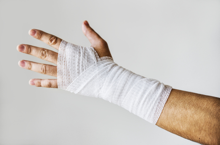 Closeup of arm wrapped with medical gauze