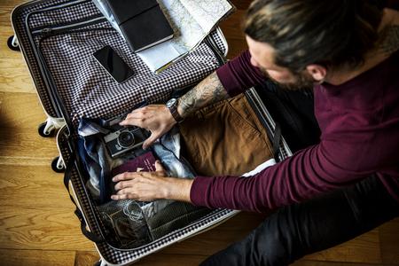 Man packing his luggage bag
