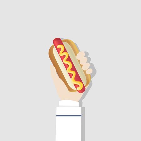 Hand holding a hotdog