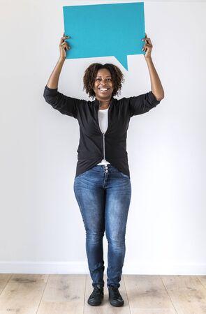 Black woman holding speech bubble icon Stok Fotoğraf