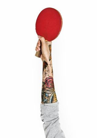 Hand holding a table tennis bat Imagens - 115556903