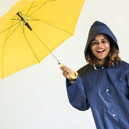 Happy girl with yellow umbrella