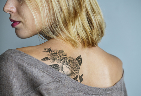Back tattoo of a woman Stockfoto
