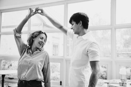Cheerful couple enjoy dancing together Stock Photo