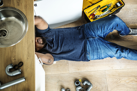 Man fixing kitchen sink