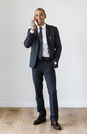Businessman standing and talking on call Stock Photo