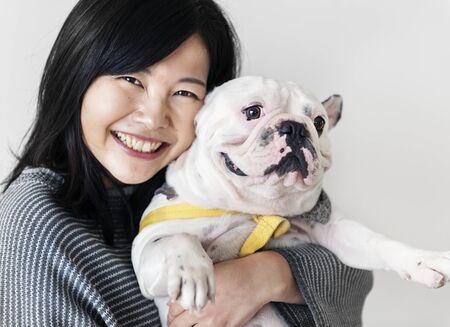Asian woman hugging dog Stock fotó