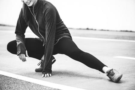 White woman stretching before exercise Stok Fotoğraf