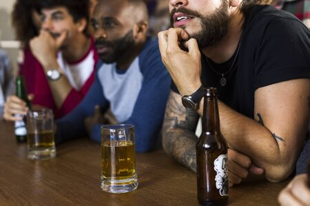 Frieds cheering sport at bar together Stock Photo